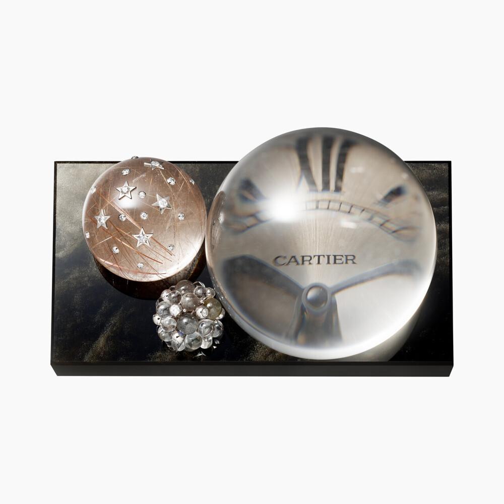 Настольные часы Les Galaxies de Cartier из золотистого обсидиана